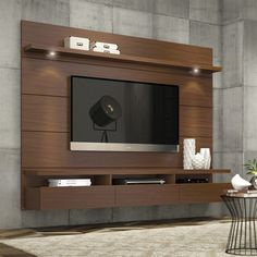 Transform your living space with this sleek and clutter-free entertainment center.