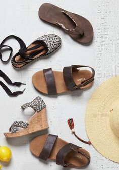Your day awaits—slip into new TOMS sandals and roam.