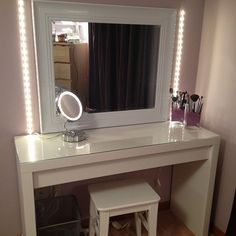 Furniture. rectangle white wooden Makeup Table with glass top and rectangle white wooden mirror plus lights on the wall. Dazzling Makeup Table With Mirror And Lights To Make Up