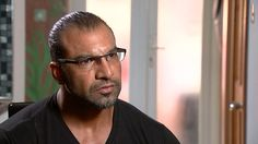 British father Mohammad Tariq Mahmood speaks of his fury after his family of 11 was pulled out of an airport line and banned from visiting Disneyland by Homeland Security.
