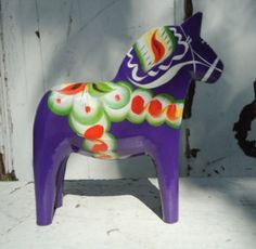 This Dala horse is way too expensive, but I really really want one!