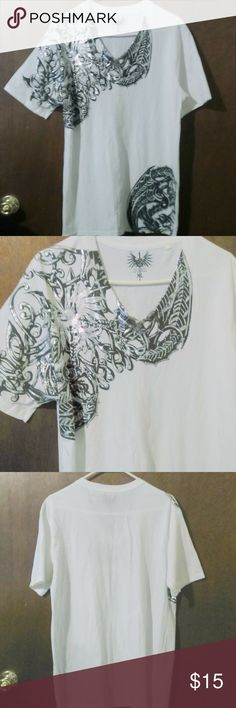 "Guess V Neck White Silver Phoenix T Shirt This V neck t shirt is made by Guess and is a size XL. It is done in a white 100% cotton and features a black and silver Phoenix design. Measurements are: Chest 46"", length 31"". In excellent condition and appears to never have been worn. Guess Shirts Tees - Short Sleeve"