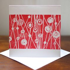 A bright and cheerful hand printed linocut greetings card featuring a bold abstract nature design. £2.50