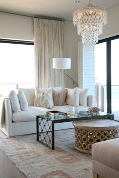 Michele Throssell Interiors > lounge > pastel > neutral > glass links chandelier
