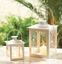 Small Ivory Color Glass Lantern; would make a great decoration at reception tables or during the ceremony!