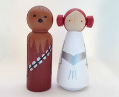 Chewbacca and Princess Leia Peg Dolls... Princess Leia and Chewbacca are perfect as wedding cake and birthday cake toppers, as well as a great gift for the Star Wars fan in your life.  They stand 3 1/2 inches tall, and have two coats of non-toxic varnish to keep them safe.