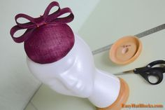 This is a step-by-step tutorial to show you how to make a sinamay pillbox hat fascinator using a wood hat block. This tutorial has a lot of photos that will guide you through this fun and easy millinery project.  #easyhatblocks #millinery #tutorial #sinamay Nice button shape.