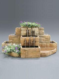 The Als Garden Art Fleur de Lis Wall Fountain is just the right