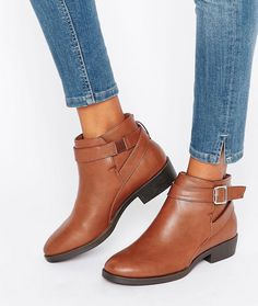 Faux leather boots with sweet buckle details and a practically nonexistent heel…