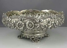 A footed Kirk repousse sterling silver centerpiece fruit bowl, the upper portion chased with flowers, ferns and leaves. It stands on four cast and applied feet. Marked S Kirk Son Co. Silver Enamel, 925 Silver, Silver Jewelry, Silver Accessories, Silver Plate, Silver Earrings, Vintage Silver, Antique Silver, Silver Pooja Items