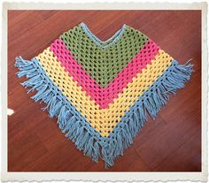 {it's like wearing a hug!} Yes, I am too cool for school.here's the proof: Using the same stitch that I used to make my first granny square I created a poncho! I think I am going to try and make one for an 18 doll too! Crochet Baby Poncho, Crochet Toddler, Crochet Poncho Patterns, Crochet Girls, Crochet Scarves, Crochet For Kids, Crochet Shawl, Knitting Patterns Free, Granny Square Poncho
