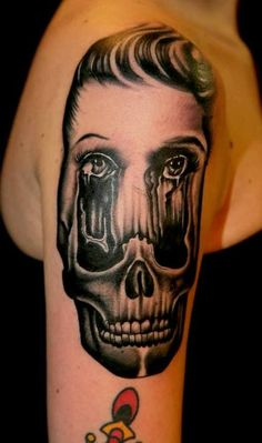 A woman's face melts into an image of a skull in this psychological portrait tattoo by Pietro Sedda