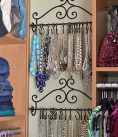 Towel rack & shower hooks used as a fun necklace hanger!