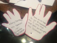 """Instead of using gift tags, I traced my boys' hands and wrote this poem, """"This is my hand for you to remember the little boy who gave you this gift this December."""" It's perfect for teachers, daycare workers, grandparents, or other family members!"""