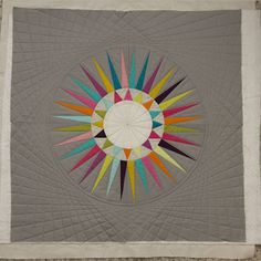 I really like the Spirograph-style quilting around the circle - but it's all done with straight lines