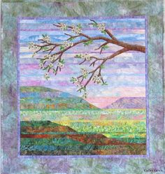 Simple strip pieced landscape quilt with appliqued branch and flowers.