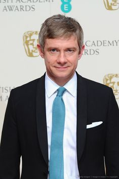 Martin Freeman poses for photos in the BAFTA press room (2-8-15)