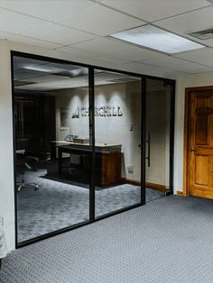 Black aluminum frame creates a nice accent that complements to the modernity of the design. Clear glass creates an open rapport, i.e. removing boundaries and creating a friendlier work environment. The office still remains private, as it is possible to add shades. #glasspartition #glassdivider #officedivider #officepartition #executiveofficeideas #officewallideas #glasswall #clearglass #privacyscreen #privacypartition #officedesignideas #modernofficedesign #crittalscreen #officewallideas Sliding Door Track, Sliding Doors, Glass Wall Design, Glass Partition Wall, Office Dividers, Interior Styling, Interior Design, Modern Office Design, Room Doors