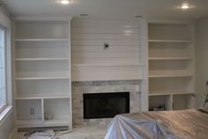 Marble subway tile with planking above fireplace