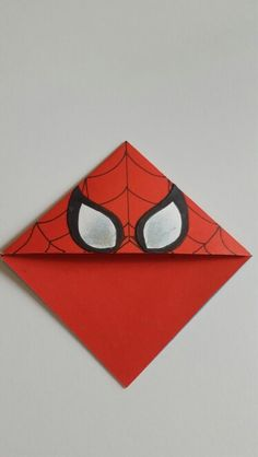 Learn how to make an origami bookmark with this easy DIY tutorial! This easy origami Diy Marque Page, Marque Page Origami, Corner Bookmarks, Bookmarks Kids, Origami Bookmark Corner, Fun Crafts, Crafts For Kids, Arts And Crafts, Spiderman Craft