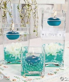 Turquoise floating candle center piece idea