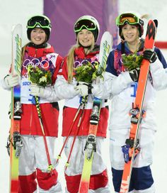 (L-R) Silver Medallist Canada's Chloe Dufour-Lapointe; Gold Medallist, Canada's Justine Dufour-Lapointe; and Bronze Medallist, US Hannah Kearney stand on the podium during the Women's Freestyle Skiing Moguls Flower Ceremony at the Rosa Khutor Extreme Park during the Sochi Winter Olympics on February 8, 2014. AFP PHOTO / JAVIER SORIANO (Photo credit should read JAVIER SORIANO/AFP/Getty Images)