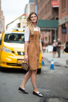 Suede dress over a white top.