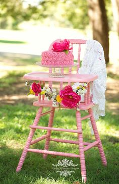Re decorated vintage high chair spray painted pink for Savvy's cake smash photo shoot. Flower vine was made using fake flowers :)  First Birthday Cake Smash Outdoor Photoshoot
