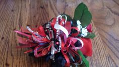 Different view of red rose wrist corsage with black accent