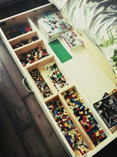 susan akins posted A cheap, easy DIY LEGO table with plenty of storage. narrow storage drawer carts from Target, plus a top board with LEGO bases glued onto it. Playroom to their -Preschool items- postboard via the Juxtapost bookmarklet. Deco Lego, Lego Room, Lego Storage, Smart Storage, Table Storage, Hidden Storage, Under Bed Storage, Cool Lego, Awesome Lego