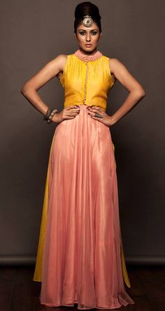 Peach gown with a yellow jacket.