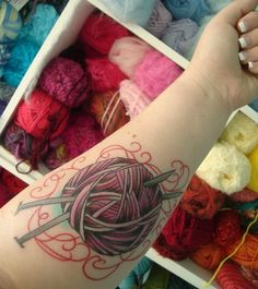 Knitting needles, yarn tattoo.