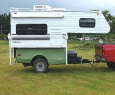 Truck camper on a pick-up bed trailer…might be a good place to start designing with a utility bed and create a garage underneath for motorcycle storage.  Have to be careful of tongue weight because the center of gravity is designed for a truck, with another axle on front.