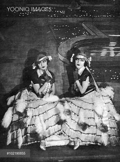 The Dolly Sisters wearing their Mazurka costumes in Paris sans Voiles, Ambassadeurs Theatre, Paris, 1923 - YOONIQ Images - Stock photos, Illustrations & Video footage