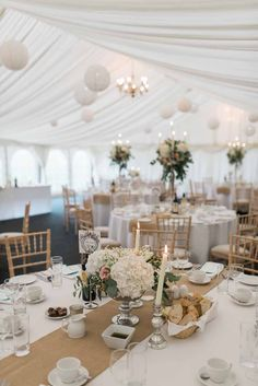 Marquee wedding at Wethele Manor footedbowl centrepieces mixed with candelabra centrepieces for summer wedding