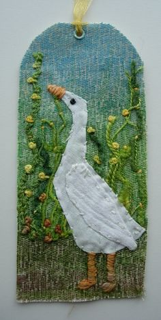 For the Tag Tuesday theme 'Goosey'  Textile tag, fabric crayons, white cotton, space dyed threads, hand embroidery. My little goose is hand appliqued white cotton with cheesecloth wing. Measures 5.7 x 12.8 cm