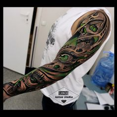 sleeve black and white and green tattoo
