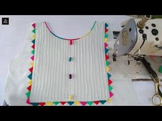 Beautiful kurti neck with colourful triangles Churidhar Neck Designs, Salwar Neck Designs, Neck Designs For Suits, Kurta Neck Design, Sleeves Designs For Dresses, Neckline Designs, Dress Neck Designs, Stylish Dress Designs, Kurta Designs