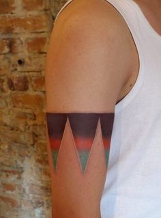 Triangular Arm Band Tattoo-- it's lined in white along the bottom :-)