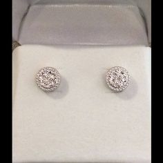Diamond Earrings Soo Pretty!! These are Sterling Silver with small diamonds on a platform that shines!! They have a gorgeous scrolled pattern around the base. They come with warranty, if you get them inspected ev 6 months at Kay Jewelers or another affiliated store, they will replace any chipped, cracked or lost stone. They are from JB Robinson which is an affiliate of Kay Jewelers. Retails for $80 Jewelry Earrings