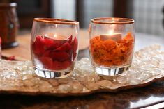 Small candles filled with marigold petals and a tea light. May be cute next to the wedding cake.