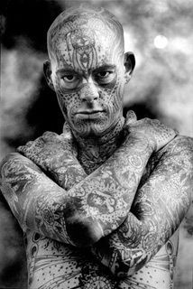 Tattooed man, Coney Island, 1990 © Harold Feinstein - Tattoos became fashionable by the 1990s and after for both men and women. In high fashion, designs on garments were made to look like tattoos. (Survey of Historic Costume)