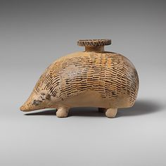 Terracotta aryballos (perfume vase) in the form of a hedgehog, mid-6th century B.C.Terracotta aryballos (perfume vase) in the form of a hedgehog Culture: Rhodian