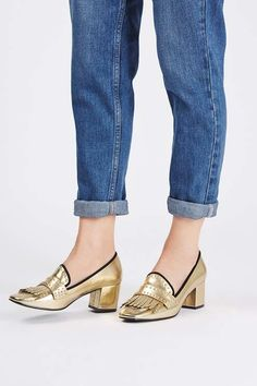 Give loafers a luxe update in this high heeled pair with a gold finish and stud detailing. #Topshop