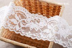 http://minglinlace.com/購物/蕾絲素材/明林蕾絲小天馬拉雪兒蕾絲條碼古典花款有彈性蕾絲台灣製米白色