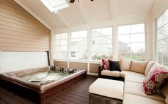 Dropping the hot tub into the floor gives this three-season porch a four season use!
