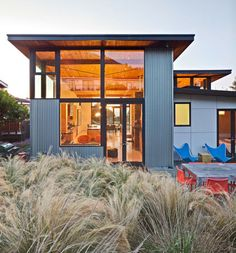 corrugated steel = an alternative material that I HEART. Could take the place of where brick is traditionally placed on my stye house?   contemporary exterior by WA design