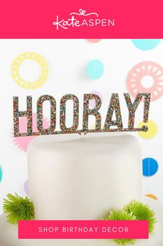 Multicolored glitter turns any cake into a party cake with our Hooray acrylic cake topper! Whether the celebration is for a birthday, graduation, or other life event, the celebrant will adore this trendy cake topper! | Hooray Multicolor Glitter Acrylic Cake Topper | Kate Aspen