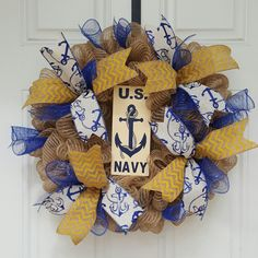 This Beautiful and vibrant Deco mesh wreath averages around 23' in diameter. Hand crafted U.S Navy sign accents the Yellow Chevron and Blue Anchor ribbon.