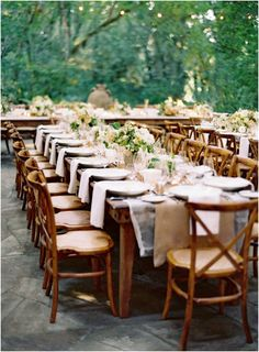 Gorgeous outdoor reception with rustic farm tables, layered linens and lush florals. #wedding #tablescape